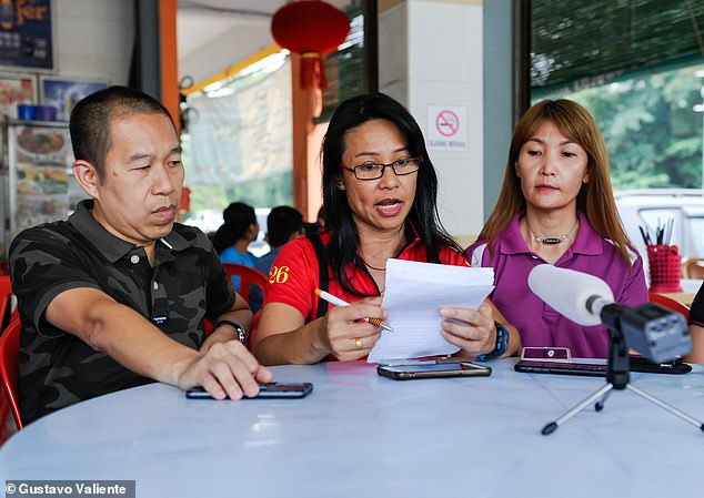 17261136-7355383-Kenny_Chan_left_Shirley_Yap_centre_and_May_Lou_right_who_were_al-a-24_1565776447002
