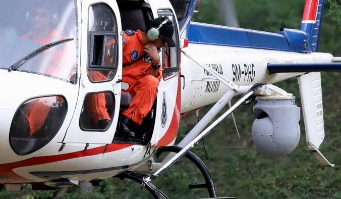 A helicopter from the Malaysian Police Air Wing Unit, equipped with a surveillance thermal imaging camera, participates in a search and rescue operation for 15-year-old Irish girl Nora Anne Quoirin who went missing from a resort in Seremban.
