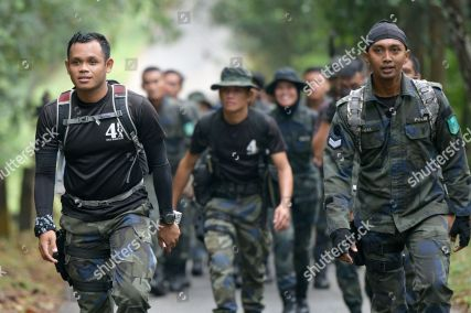 Mandatory Credit: Photo by Sanghwan Jung/Shutterstock (10358910k) Members of a police team conduct a search and rescue operation for a missing British girl, Nora Quoirin 15-year-old at the forest in Seremban, Negeri Sembilan British teenager Nora Quoirin missing in Malaysia - 10 Aug 2019 Nora disappeared while on a holiday with her family at The Dusun resort in a nature reserve near Seremban, about 80 km south of Kuala Lumpur, Malaysia. Nora has been missing in her bedroom on 04 August 2019