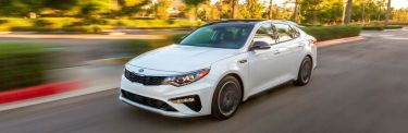 2020_Kia_Optima_in_white_driving_on_road_o